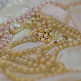 Pearls and satin with embroidery by Cordia Murphy