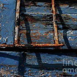 Peeling blue paint and orange rust on hull of old fishing boat, Watten, Hauts-de-France, France by Terence Kerr