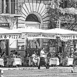 People Dining Outside An Osteria on the Square - Italy  by Stefano Senise