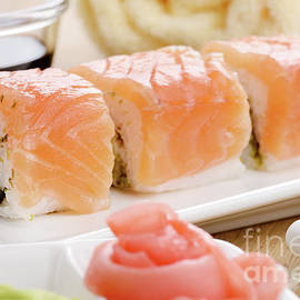 Philadelphia roll sushi on a white plate with soy sauce wasabi a by Dmytro Mykhailov