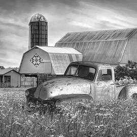 Pickup Truck in the Farm Wildflowers Black and White  by Debra and Dave Vanderlaan