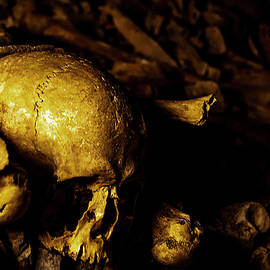 Skull and Bones in the Catacombs 1 by John Twynam