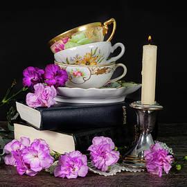 Pink carnations and vintage tea cups by Katia Kovan