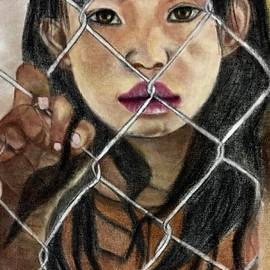 Portrait of a young girl behind a chain link fence by Lakshmi Rajagopal