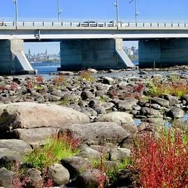 Prehistoric rocks and modern bridge by Stephanie Moore