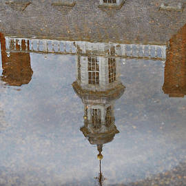 Puddle Reflection of the Governor's Palace by Marilyn DeBlock