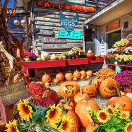 Pumpkins at the Farm Market Barn by Debra and Dave Vanderlaan