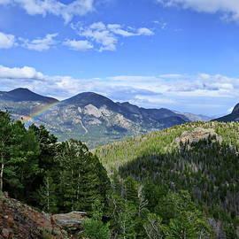 Rainbow in Rocky Mountain National Park by Lyuba Filatova