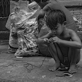 Recycler Boy in Manila by Kirkland Worobec