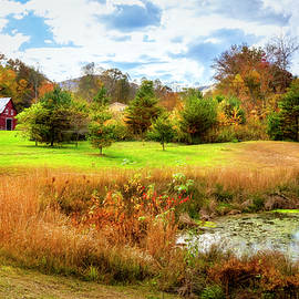 Red Barn at the Pond by Debra and Dave Vanderlaan
