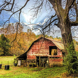 Red Barn in Autumn's Embrace by Debra and Dave Vanderlaan