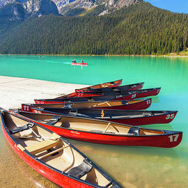 Red Canoes on Lake Louise, Banff national Park, Alberta, Canada by Neale And Judith Clark