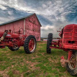 Red Farmall Tractor and Pink Barn by Joann Vitali