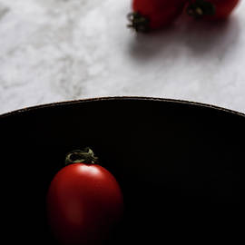 Red fresh healthy tomatoes isolated on a black pan by Michalakis Ppalis