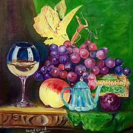 Red grapes by Khalid Saeed