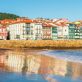 Reflections in the sand of the town of Lekeitio by ACAs Photography
