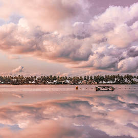 Reflections of Clouds at Sunset  by Debra and Dave Vanderlaan