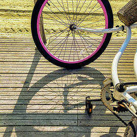 Resting Bike And Shadows On Boardwalk by Gary Slawsky