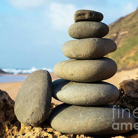 Rock balancing stone stack, Algarve, Portugal by Neale And Judith Clark