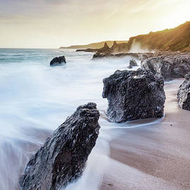 Rocks at Great Mattiscombe Sands, Devon by Justin Foulkes