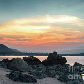 Rocky Beach At Sunset by Michelle Meenawong