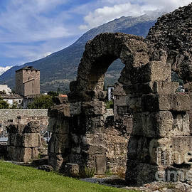Roman ruins with medieval Tower of the Bailiffs in Aosta Valley in northern Italy by Terence Kerr
