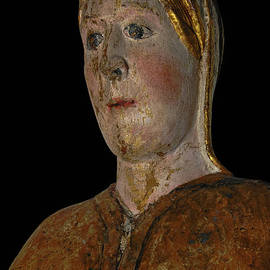 Rosy-cheeked Virgin Mary with wide blue eyes - 12th century wooden polychrome statue, France by Terence Kerr
