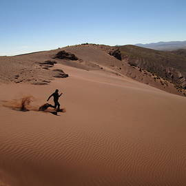 Running down a sand dune in the Bolivian mountains by Florin Wahl