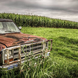 Rusting By The Cornfield by Jim Love