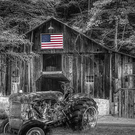 Rusty Tractor in America in Black and White with Red White and B by Debra and Dave Vanderlaan