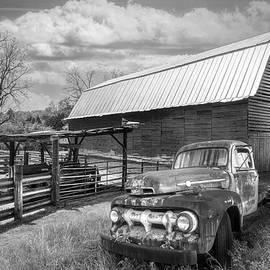 Rusty Truck at the Barn in Black and White  by Debra and Dave Vanderlaan