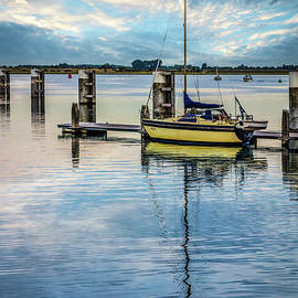 Sailboat in a Peaceful Harbor by Debra and Dave Vanderlaan