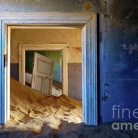 Sand inside Doorway in Building of Namibian Desert Ghost Town by Tom Schwabel