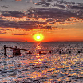 Sandy Hook New Jersey beach at sunset  by Geraldine Scull