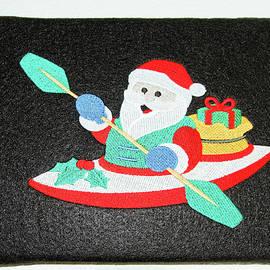 Santa Claus Paddling Kayak by Sally Weigand