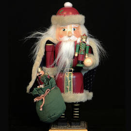 Santa Cracks Nuts by Michael Riley