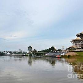 Sarawak state assembly parliament building with bridge across river Kuching East Malaysia by Imran Ahmed