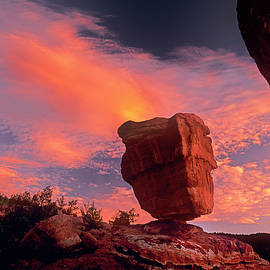 Scarlet Sunrise Behind Balanced Rock, Garden Of The Gods City Park, Colorado Springs by Bijan Pirnia