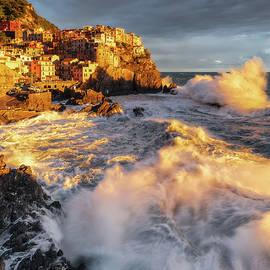 Sea storm at sunset in Manarola by Giovanni Laudicina