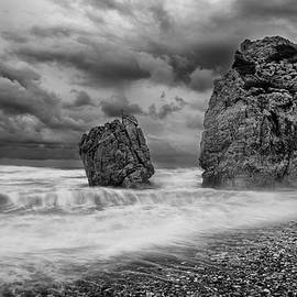 Seascape with windy waves during storm weather a  rocky coastlin by Michalakis Ppalis
