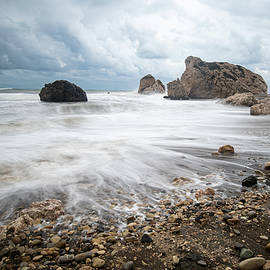 Seascape with windy waves during stormy weather on a rocky coast by Michalakis Ppalis