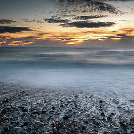 Seawaves splashing on the coast during a dramatic sunset by Michalakis Ppalis