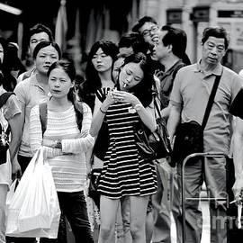 Sidewalk crossing in Mong Kok by Michael Martin