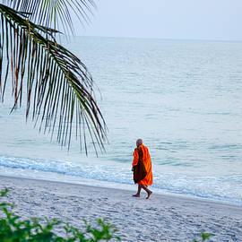 Silhouette of monk walk by the sea , Thailand by Tamara Sushko