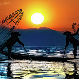 Silhouettes Of Burmese Fishermen by Chris Lord