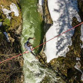 Slack Line Over Beautiful River by Rick Neves