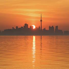 Sliced Tangerine Sunrise - Toronto Skyline Carving the Sun Disk by Georgia Mizuleva