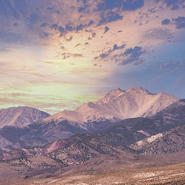 Snow Capped Mtns Sunset by Randall Branham