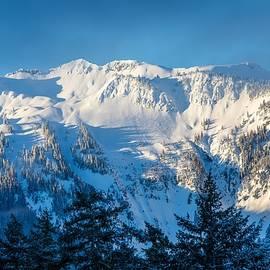 Snow covered hills by Lynn Hopwood