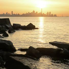 Soft Gold and Rough Rocks - Brilliant Sunrise Right Above Toronto CN Tower by Georgia Mizuleva